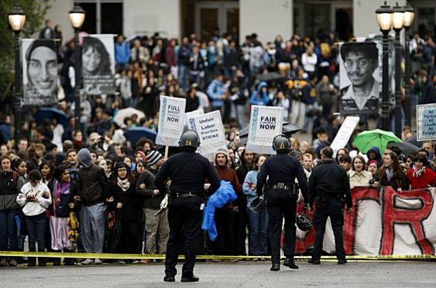 UC Berkeley students rally in front of Wheeler Hall against proposed pay cuts, layoffs, and tuition hikes in 2009. Photo: Michael Macor, The Chronicle